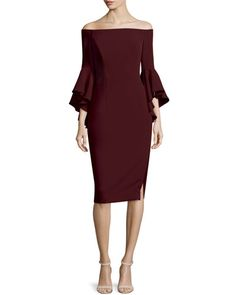 "Milly ""Selena"" dress in Italian cady. Approx. length: 37.5""L down center back. Off-the-shoulder neckline. Three-quarter fluted sleeves. Sheath silhouette. 12""L thigh-high slit at left leg. Straight he"
