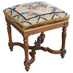 """Nineteenth century hand carved walnut Louis XVI style footstool with original needlepoint. 17"""" H X 16"""" Square"""