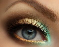 Cover entire eyelid in white eyeliner and bottom line also Lid: gold/ rusty yellow with same color on outer corners of eye..with teal green / subtle sea green on inner corner of eye fading into the golde Crease: subtle dark brown