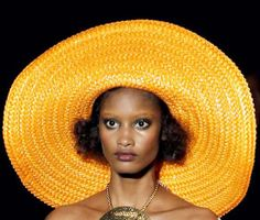 79c57170095 Hats that were seen on the runways of Spring Summer 2011 were mostly huge  brim hats and some other versions like bucket hats with hanging tassels and  other ...