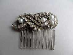 Jewelry for the hair. Brooch is repurposed into a hair comb.