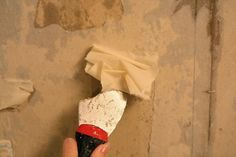 removing old wall paper from unprimed drywall: answer - SOAK it first