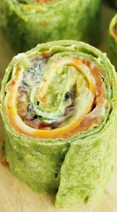 7- Layer Dip Tortilla Pinwheels (GIMME GIMME THESE LOOK SO GOOD IM GOIN TO MAKE THESE 2DAY 4 ME AND MY MOM)