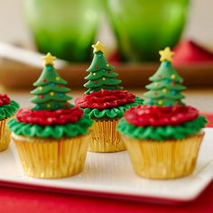 The Wilton Mini Christmas Tree Royal Icing Decorations make these mini cupcakes stand out on your Christmas dessert table.