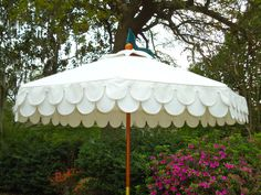 Boutique Tents 6' diameter wood frame umbrella with Sunbrella cover and double scallop valance.
