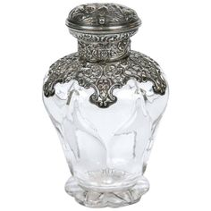 Antique 1904 William Comyns Sterling Silver and Crystal Perfume Bottle   From a unique collection of antique and modern vases and vessels at https://www.1stdibs.com/furniture/decorative-objects/vases-vessels/