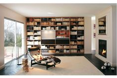 Une bibliothèque sur mesure du sol au plafond Photographe : DR