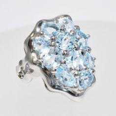 KAUFMANN de SUISSE | ❧ The Blue Ice Topaz Ring — FLowing Lines Collection