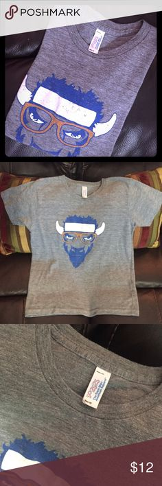 Boys OKC Thunder Basketball Mascot Rumble Shirt Comfy, soft & cute Rumble OKC Thunder Shirt! Lightly worn. Says size 10, but runs smaller. 7/8 & 9 would be around the best size. Shirts & Tops Tees - Short Sleeve