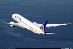 A United 787-8 looking great as it departs LAX backed by the Pacific Ocean.