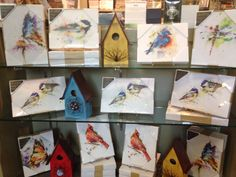 A selection of prints and birdhouses available in The Garden Store