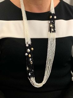 For Sale on 1stdibs - Glimmering grayish, silver Keshi Pearls cascade elegantly in multi strands in this spectacular necklace. Randomly placed 9 mm iridescent black Tahitian
