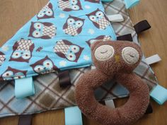 I'd like to find this pattern fabric to make my own baby blanket. Brown & Blue Owl Tag Blanket  baby boy blanket by Crafting4Caleb, $12.50