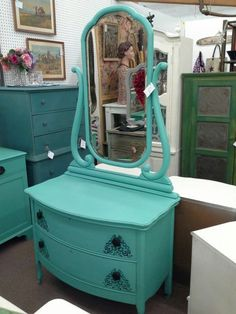 $177 - This antique chest has an original mirror with a wide bevel. The chest has been painted turquoise , black knobs and stenciling and lightly distressed. The dresser measures 35 inches across the front, 19 inches deep and it stands 28 inches tall , the mirror adds an additional 42 inches in height. It can be seen in booth H 7 at Main Street Antique Mall 7260 East Main St ( E of Power Rd ) Mesa 85207  480 9241122open 7 days 10 till 530 Cash or charge 30 day layaway also avai...