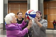 Barbara Bush with a basketball spinning on her finger
