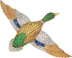Colored Diamond, Diamond, Multi-Stone, Platinum, Gold Brooch, Oscar Heyman Bros. The brooch features full-cut yellow diamonds weighing 2.35 carats, enhanced by round-cut emeralds weighing 1.93 carats, accented by baguette-cut sapphires weighing 0.75 carat, complemented by ruby cabochons, set in platinum and 18k gold, maker's mark for Oscar Heyman Bros (yellow diamonds not tested for origin of color). Gross weight 33.90 grams.