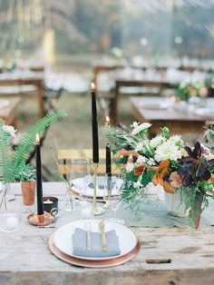 Designing with an aesthetic that was organic, casual, a bit wild, and somewhat moody, the centerpieces mixed soft flowers with variegated foliage