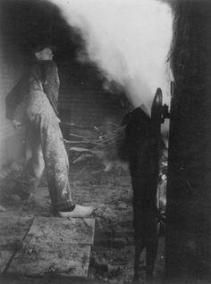 Stoking with fagots at Pottenbakkerij de Olde Kruyk, Milsbeek, Limburg, Netherlands 1950's