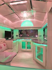 OMTTT! This is how I was planning my tiny travel trailer interior. Not as elaborate but same colors and cabinets with lucite windows that could be lit from the inside.