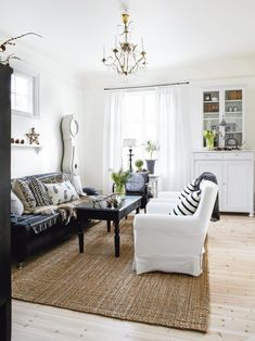 Two reasons I will be glad when my child turns into a mom-hating adolescent: white slipcovers and sisal rugs. (But I could probably swing the chandelier now.)