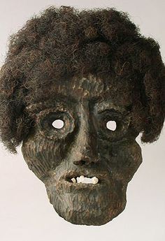 Roitschaeggaetae Mask. Loetsch Valley, Wallis Canton, Switzerland. Young men would wear these masks, which they carved themselves, and dress in mottled furs covered in a mixture of soot, blood and manure, and then chase the frightened villagers. The mask is also called a Shrovetide mask.