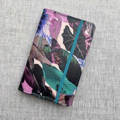 Cover for Moleskine pocket size journal in black, lilac and turquoise leather