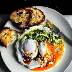 {recipe} Turkish cilbir with a twist. Poached eggs on a bed of garlicky Greek yogurt, bathed in Aleppo chili butter and pickled chili chimichurri.