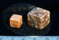 2 cubic dice, marble, BM 1772/3-11/238 and 1814/7-4/1088