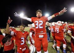 . MARK LAMBIE�EL PASO TIMES  Bel Air running back Samuel Workman celebrates with teammates after dismantling Andress at Bel Air High School Friday.
