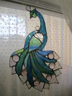 Peacock Stained Glass Sun Catcher Hanging Decor. $46.00, via Etsy. by gypsiejenn