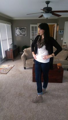 Very simple look. White tank, black cardigan with sheer ruffles along the bottom. Paired with dark jeans, cuffed above my Toms wedges. Infinity scarf in leopard print from LOFT.