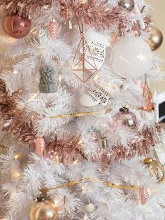 white christmas tree with rose gold and pink decorations- because I found a 5 dollar Christmas tree at a garage sale!