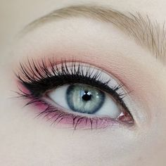Blue eyes with makeup for women. Beauty trends.