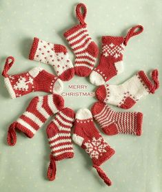 knitted mini christmas stockings - Free knitting patterns designed by Julie at Little Cotton Rabbits. Knit Christmas Ornaments, Mini Christmas Stockings, Mini Stockings, Stocking Ornaments, Crochet Christmas, Knitted Christmas Stocking Patterns, Knitted Christmas Decorations, Christmas Patterns, Handmade Ornaments