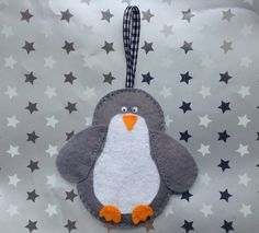 A personal favorite from my Etsy shop https://www.etsy.com/listing/235543976/felt-penguin-hanging-decoration-in-grey