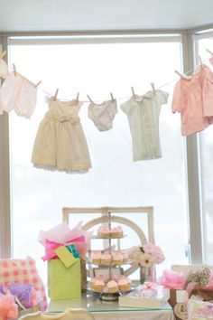 baby is brewing antique shabby chic vintage theme tea party baby shower clothesline banner over cupcake tower
