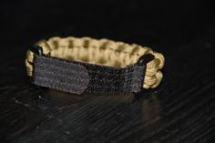 Paracord Survival Bracelet with Velcro Coyote by CordNinja. Paracord Survival Bracelet with Velcro - Coyote.
