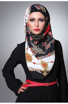 Hijab, black maxi dress with a red belt.  Proving traditional Muslim woman can still be hot.