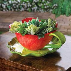 A fairy-tale teacup is larger than life in luscious red and vibrant green! Playful planter is shaped like a fresh-cut flower complete with its leafy base; a perfect perch for your loveliest plant.Drain hole in bottom. $15.00  If interested please contact me at tcabeza@ca.rr.com