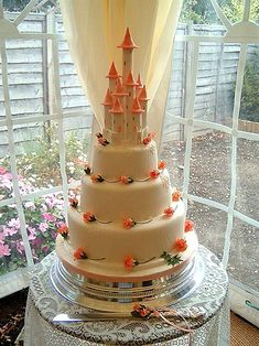 Fairy Castle Wedding Cake: Taken from a design by Ann Pickard. Huge 3 tier cake with cream  orange blossoms - Created by Christine Hamilton