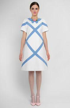 A-shape thick cotton dress with ribbon trim. Round neck. Designer handmade rose. Hidden back zip closure. Without pockets.