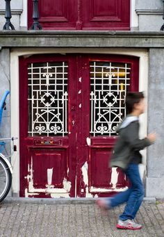 Typical canal house door #amsterdam #canal #red #door #patina