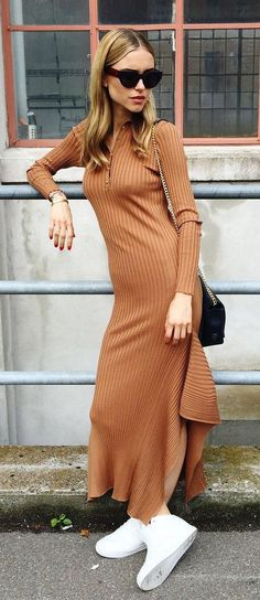 Pernille Teisbaek steps out in a Stella McCartney knit dress, H&M sneakers, Leowulff bag, and Céline sunglasses