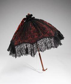 Parasol  Date: 1885 Culture: British (probably) Medium: silk, wood, metal Dimensions: 34 1/2 in. (87.6 cm)  Costume Collection at The Metropolitan Museum of Art  Accession Number: 2009.300.2337