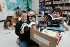 Students examine their new books purchased by their school's #Indigo #LoveOfReading grant. (2005) #IndigoLOR10