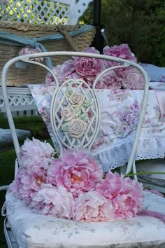 Pink peonies on the cottagey vintage chair...