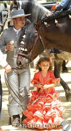 Feria in Spain, proud man with beautiful horse & daughter.  http://www.costatropicalevents.com/en/cultural/festivals.html
