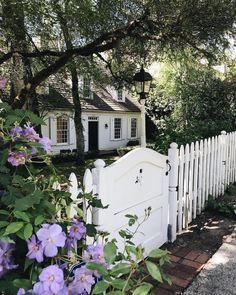 This is a white, picket fence dream-come-true, with just a dash of purple! 💜 Double tap if this is the home of your dreams! #travelThursday…