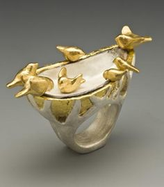 """Rika Mouw: """"Bird Baht Ring"""". Sterling silver, 22 k gold, gold leaf and mussel shell."""