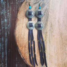 Boho Long Leather Fringe Turquoise Concho Earrings These handmade long black leather concho earrings have a turquoise stone accent, they measure 7 in. long. Jewelry Earrings